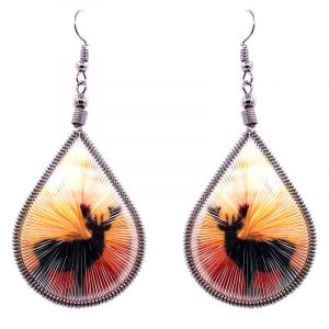 Teardrop-shaped thread dangle earrings with alpaca silver wire and deer silhouette graphic image in orange, gold, and black color combination.