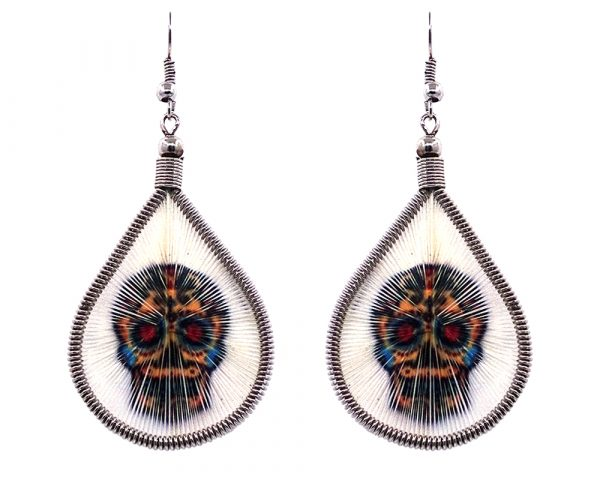 Teardrop-shaped thread dangle earrings with alpaca silver wire and Day of the Dead sugar skull graphic image in white, golden yellow, and multicolored color combination.