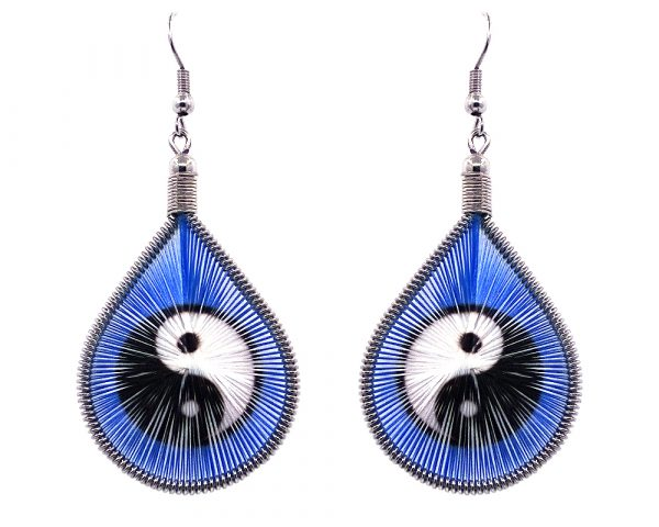 Teardrop-shaped thread dangle earrings with alpaca silver wire and black and white yin yang graphic image in blue color.
