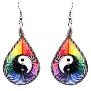 Teardrop-shaped thread dangle earrings with alpaca silver wire and black and white yin yang graphic image in rainbow colors.