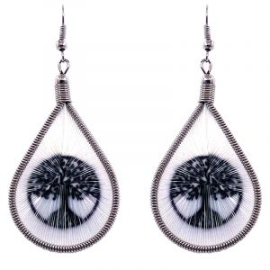 Teardrop-shaped thread dangle earrings with alpaca silver wire and tree of life graphic image in black and white color combination.