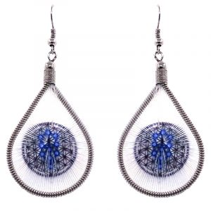 Teardrop-shaped thread dangle earrings with alpaca silver wire and Kabbalah Flower of Life sacred geometry graphic image in white, black, and blue color combination.