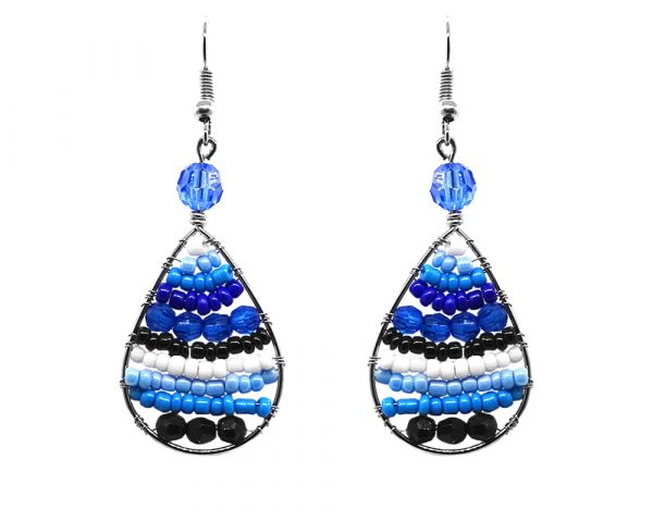 Teardrop-shaped striped seed bead and alpaca silver metal earrings in blue, turquoise, white, and black color combination.