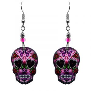 Day of the Dead bow sugar skull head acrylic dangle earrings with beaded metal hooks in pink, red, and black color combination.