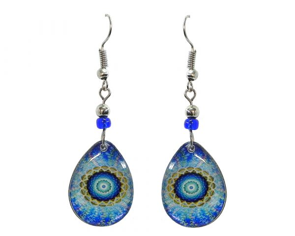 Teardrop-shaped New Age themed mandala graphic acrylic dangle earrings with beaded metal hooks in light blue, turquoise, white, and lime green color combination.