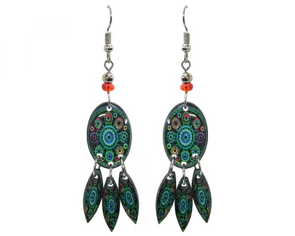 Oval-shaped New Age themed mandala gears graphic acrylic earrings with long matching dangles and beaded metal hooks in teal green, orange, and black color combination.