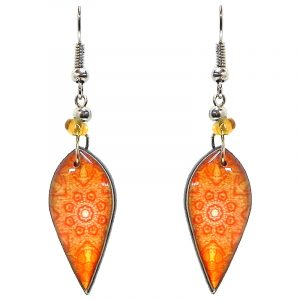 Ellipse-shaped New Age themed mandala graphic acrylic dangle earrings with beaded metal hooks in orange and white color combination.