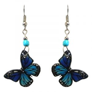Monarch butterfly acrylic dangle earrings with beaded metal hooks in turquoise, blue, and black color combination.