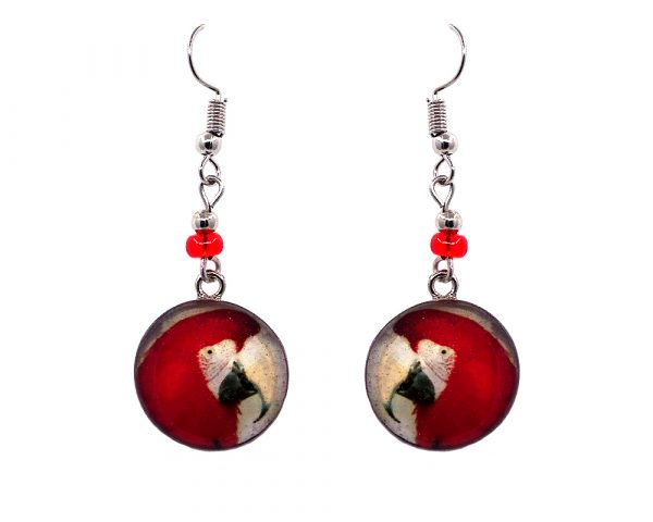 Round-shaped macaw parrot graphic acrylic dangle earrings with silver metal setting and beaded metal hooks in red, white, and black color combination.