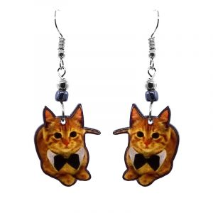 Laying bowtie Tabby cat acrylic dangle earrings with beaded metal hooks in orange, golden, white, and black color combination.