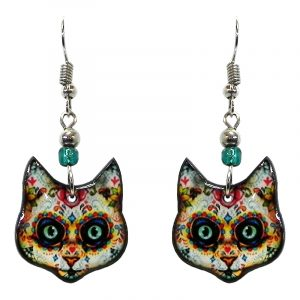 Day of the Dead sugar skull pattern cat face acrylic dangle earrings with beaded metal hooks in white, golden yellow, and multicolored color combination.