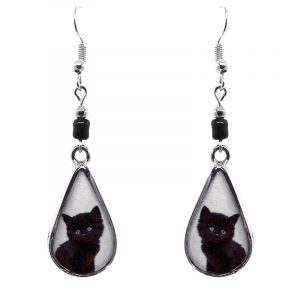 Teardrop-shaped Black kitten cat face graphic acrylic dangle earrings with silver metal setting and beaded metal hooks in white and black color combination.