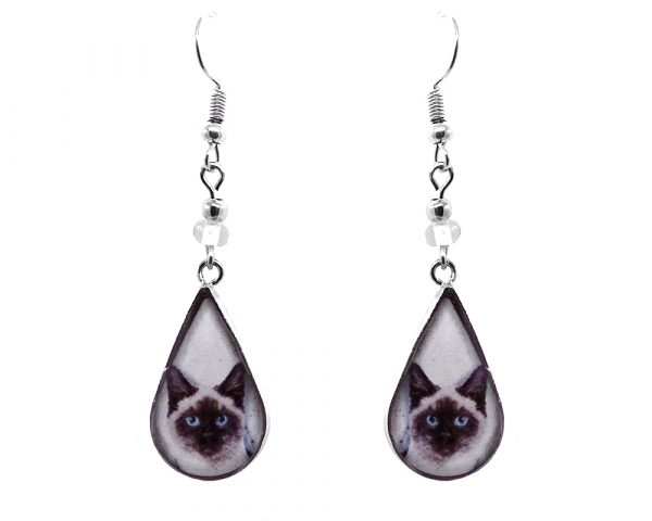 Teardrop-shaped Siamese cat face graphic acrylic dangle earrings with silver metal setting and beaded metal hooks in white, dark brown, and beige color combination.