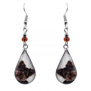 Teardrop-shaped Yorkie dog face graphic acrylic dangle earrings with silver metal setting and beaded metal hooks in white, brown, and black color combination.