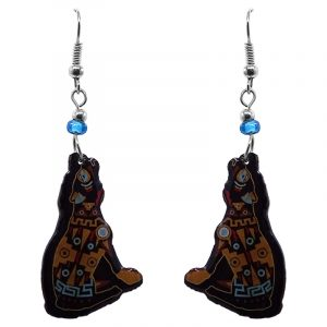 Tribal pattern howling coyote acrylic dangle earrings with beaded metal hooks in golden yellow, black, and light blue color combination.
