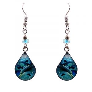 Teardrop-shaped dolphin graphic acrylic dangle earrings with silver metal setting and beaded metal hooks in turquoise, teal, blue, black, and white color combination.