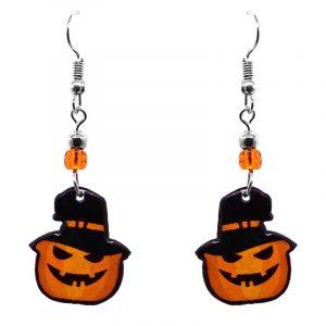 Halloween themed Jack O' Lantern pumpkin acrylic dangle earrings with beaded metal hooks in orange and black.