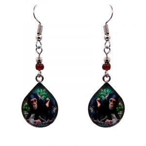 Teardrop-shaped chimpanzee monkey graphic acrylic dangle earrings with silver metal setting and beaded metal hooks in dark brown and green color combination.