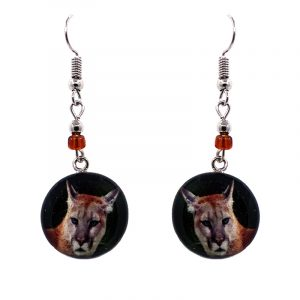 Round-shaped puma graphic acrylic dangle earrings with silver metal setting and beaded metal hooks in beige and black color combination.