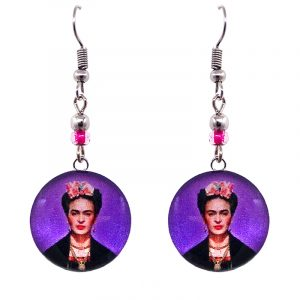 Handmade round silver Frida Kahlo earrings with acrylic, seed beads, and metal hooks in purple, peach, salmon pink, and black color combination.