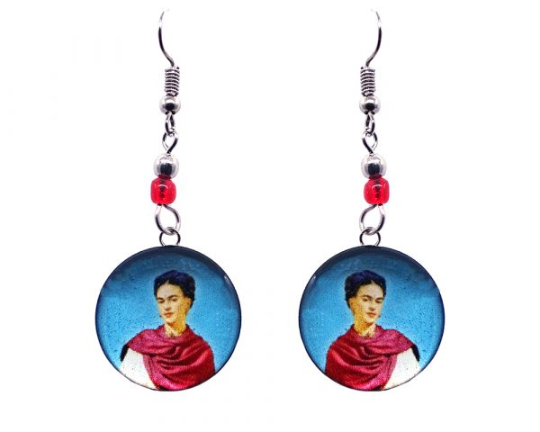 Handmade round silver Frida Kahlo earrings with acrylic, seed beads, and metal hooks in light blue, beige, hot pink, white, and black color combination.