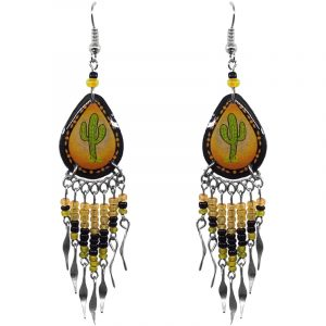 Handmade teardrop-shaped ceramic earrings with handpainted tribal pattern saguaro cactus graphic design and long seed bead and alpaca silver metal dangles in golden yellow, orange, black, and lime green color combination.
