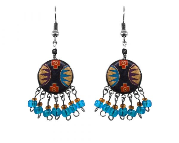 Handmade round-shaped ceramic earrings with handpainted tribal pattern design and short seed bead and alpaca silver metal dangles in turquoise blue, gold, black, red, and dark purple color combination.