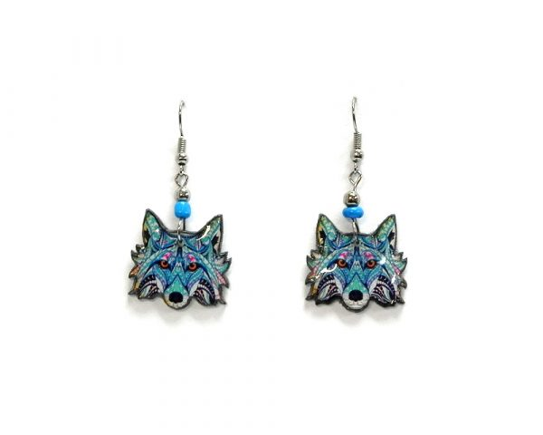 Tribal pattern wolf face acrylic dangle earrings with beaded metal hooks in light blue, turquoise, dark blue, white, and hot pink color combination.