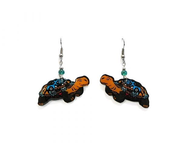 Tribal pattern land turtle acrylic dangle earrings with beaded metal hooks in turquoise blue, tan, black, and white color combination.