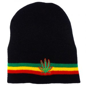 Handmade black knit beanie hat with horizontal stripes and embroidered green leaf patch in Rasta colors.