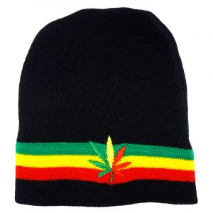 Handmade black knit beanie hat with horizontal stripes and embroidered leaf patch in Rasta colors.