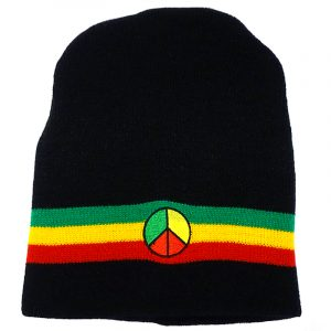 Handmade black knit beanie hat with horizontal stripes and embroidered peace sign patch in Rasta colors.