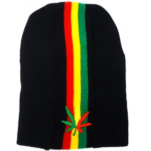 Handmade black knit beanie hat with vertical stripes and embroidered leaf patch in Rasta colors.