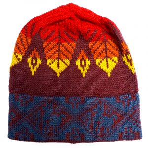 Handmade Peruvian tribal knit beanie hat with handwoven alpaca wool and leaf tribal print pattern in burgundy, red, orange, and yellow colors.
