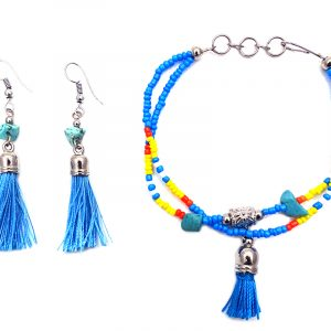Handmade Native American inspired seed bead multi strand bracelet with silk thread tassel dangle and matching tassel earrings with chip stones in turquoise blue, orange, yellow, and white color combination.