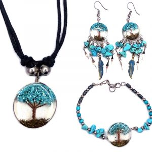 Handmade hematite, chip stone, and silver metal seed bead bracelet with round-shaped clear acrylic resin, copper wire, and crushed chip stone inlay tree of life centerpiece, a matching necklace, and matching feather charm dangle earrings in turquoise howlilte.