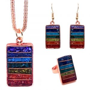 Rectangle-shaped acrylic resin, copper wire, and crushed chip stone inlay orgonite necklace, matching earrings, and matching ring with 7 chakra rainbow striped pattern and copper metal setting.