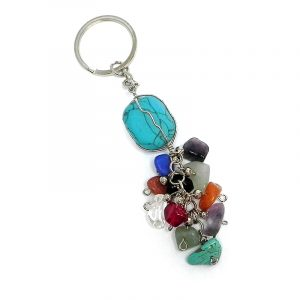 Handmade wire wrapped tumbled gemstone crystal with multicolored chip stone cluster dangle on silver metal key ring in turquoise blue howlite.