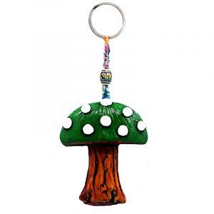 Handmade durepox resin figurine keychain of a toadstool Amanita magic mushroom in green and white color combination.