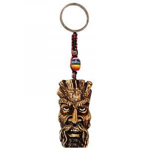 Handmade durepox resin figurine keychain of a brown tree man face.
