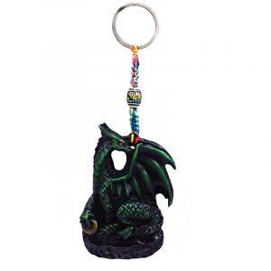 Handmade durepox resin figurine keychain of a green dragon holding a stone.
