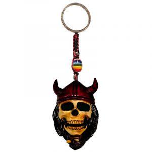 Handmade durepox resin figurine keychain of a viking skull with a red horned helmet.