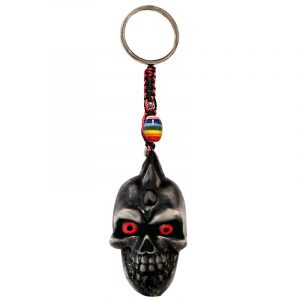 Handmade durepox resin figurine keychain of a gray skull with a spiked mohawk.