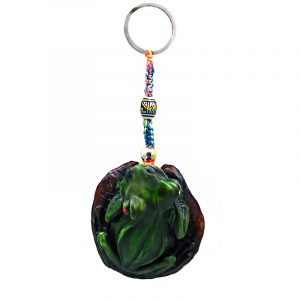 Handmade durepox resin figurine keychain of a sitting green tree frog with red eyes.