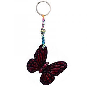 Handmade durepox resin figurine keychain of a dark pink butterfly.