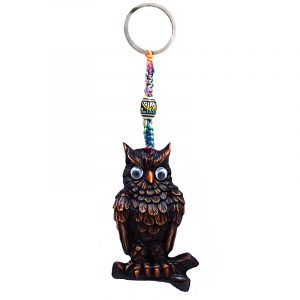 Handmade durepox resin figurine keychain of a perched owl on a branch with googly eyes in brown color.