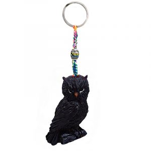 Handmade durepox resin figurine keychain of a perched owl on a branch in black color.