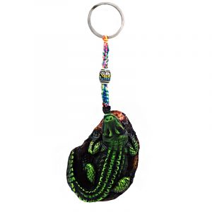 Handmade durepox resin figurine keychain of a green alligator on a rock.