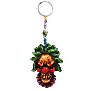 Handmade durepox resin figurine keychain of an evil clown head with a creepy smile and red nose.