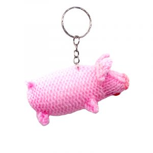 Handmade wool finger puppet keychain of a pig with silver metal key ring in pink color.